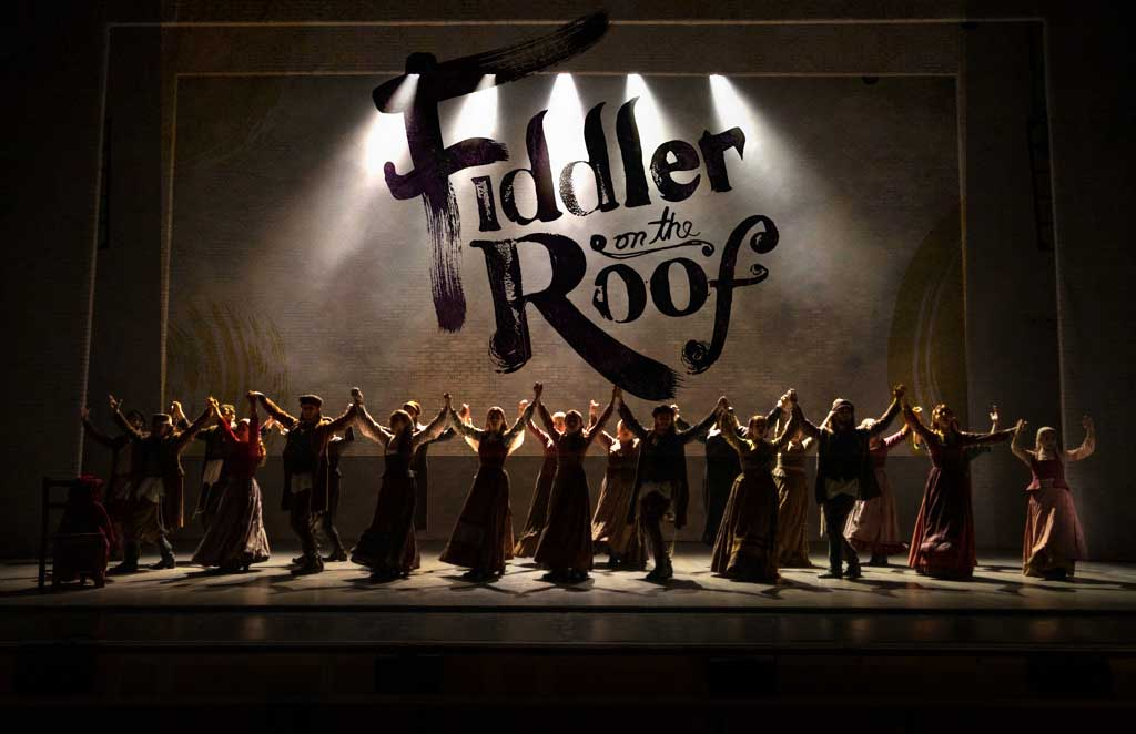 Fiddler on the Roof cast on stage